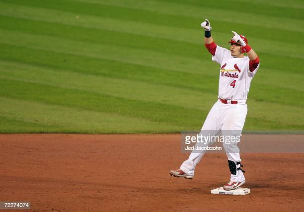 Yadier Molina of the St Louis Cardinals celebrates after he hit a RBI double to score Scott Rolen in the bottom of the fourth against the Detroit...