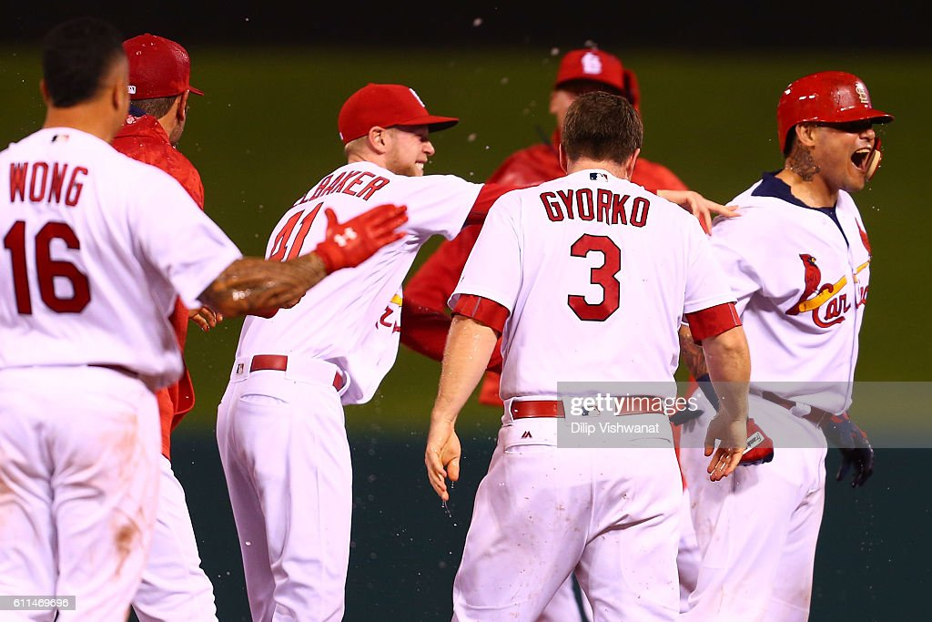 Yadier Molina #4 of the St. Louis Cardinals celebrates after hitting a walk-off double against the Cincinnati Reds in the ninth inning at Busch Stadium on September 29, 2016 in St. Louis, Missouri.