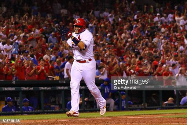 Yadier Molina of the St Louis Cardinals celebrates after hitting a grand slam against the Kansas City Royals in the sixth inning at Busch Stadium on...