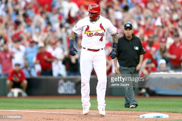 Yadier Molina of the St Louis Cardinals celebrates after hitting an RBI gametying single against the Atlanta Braves during the eighth inning in game...