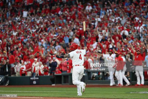 Yadier Molina of the St Louis Cardinals celebrates as he hits a walkoff sacrifice fly to give his team the 54 win over the Atlanta Braves in game...