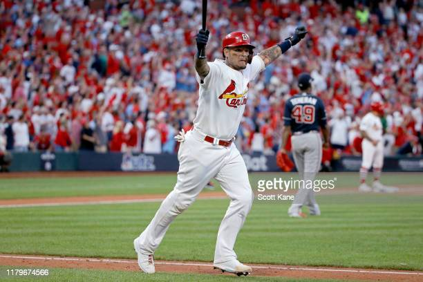 Yadier Molina of the St. Louis Cardinals celebrates as he hits a walk-off sacrifice fly to give his team the 5-4 win over the Atlanta Braves in game...