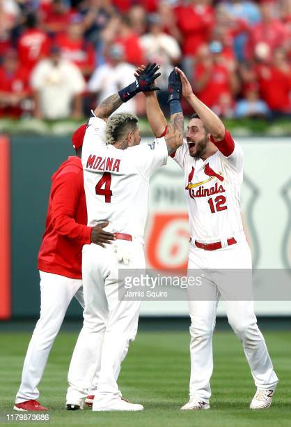 Yadier Molina of the St Louis Cardinals celebrates with Paul DeJong after he hits a walkoff sacrifice fly to give his team the 54 win over the...