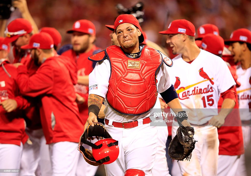 Yadier Molina #4 of the St. Louis Cardinals celebrates with teammates after defeating the Los Angeles Dodgers in Game Four of the National League Divison Series at Busch Stadium on October 7, 2014 in St Louis, Missouri.