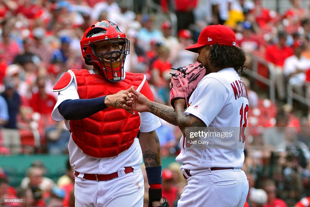 Yadier Molina #4 of the St. Louis Cardinals congratulates Carlos Martinez #18 as they walk off the field during the seventh inning at Busch Stadium on May 2, 2018 in St Louis, Missouri.