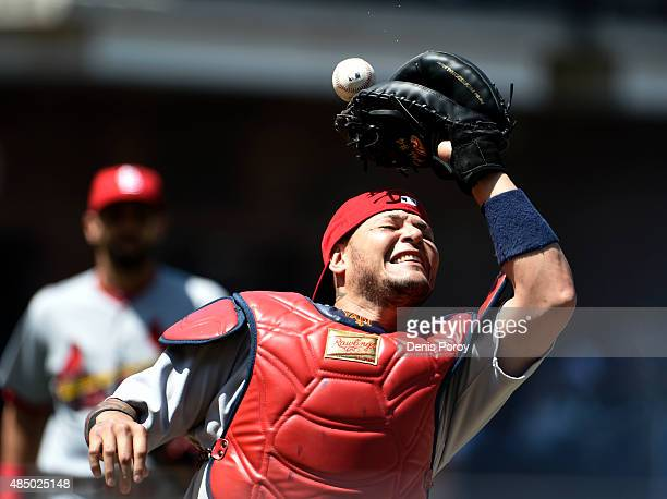 Yadier Molina of the St Louis Cardinals drops a foul ball hit by Yangervis Solarte of the San Diego Padres during the first inning of a baseball game...