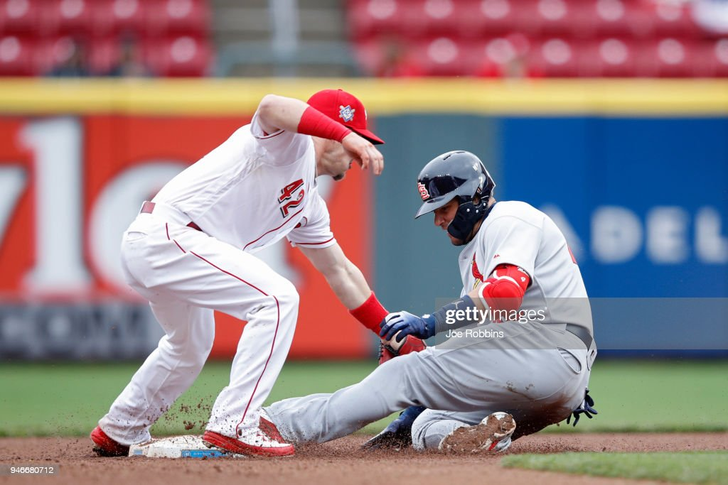 Yadier Molina #4 of the St. Louis Cardinals gets tagged out by Scooter Gennett #3 of the Cincinnati Reds trying to reach second base after a single in the seventh inning of the game at Great American Ball Park on April 15, 2018 in Cincinnati, Ohio. The Cardinals won 3-2. All players are wearing #42 in honor of Jackie Robinson Day.