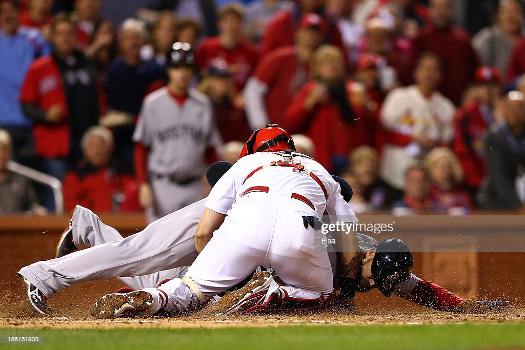 Yadier Molina #4 of the St. Louis Cardinals gets the out on David Ross #3 of the Boston Red Sox at home plate in the seventh inning during Game Five of the 2013 World Series at Busch Stadium on October 28, 2013 in St Louis, Missouri.