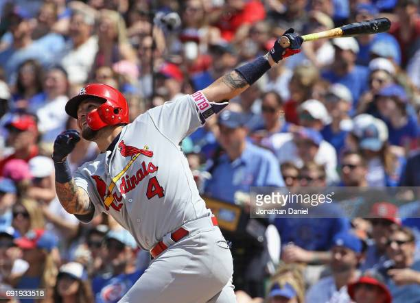 Yadier Molina of the St Louis Cardinals hits a solo home run in the 6th inning against the Chicago Cubs at Wrigley Field on June 3 2017 in Chicago...