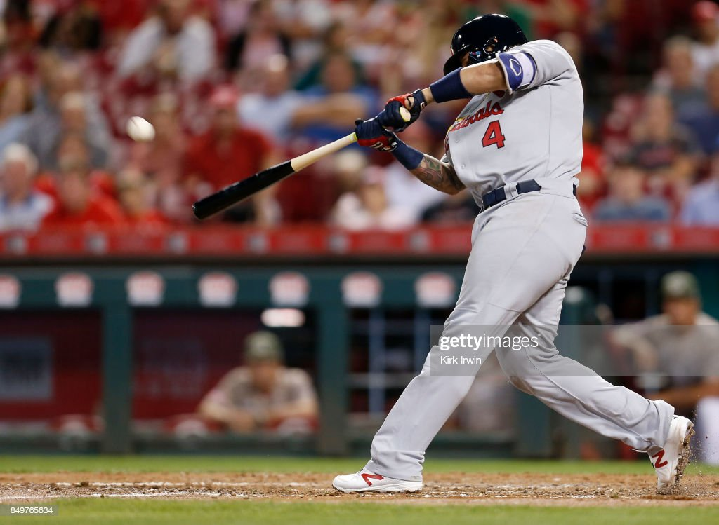 Yadier Molina #4 of the St. Louis Cardinals hits a three-run home run in the fourth inning of the game against the Cincinnati Reds at Great American Ball Park on September 19, 2017 in Cincinnati, Ohio.