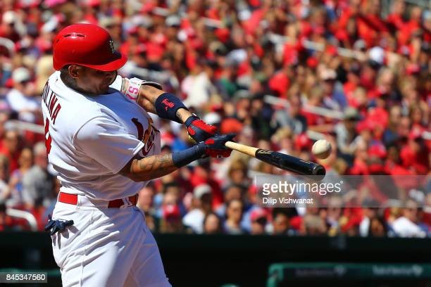 Yadier Molina of the St Louis Cardinals hits a threerun home run against the Pittsburgh Pirates in the third inning at Busch Stadium on September 10...