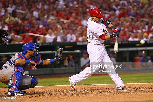Yadier Molina of the St Louis Cardinals hits a twoRBI double against the Chicago Cubs at Busch Stadium on May 14 2012 in St Louis Missouri
