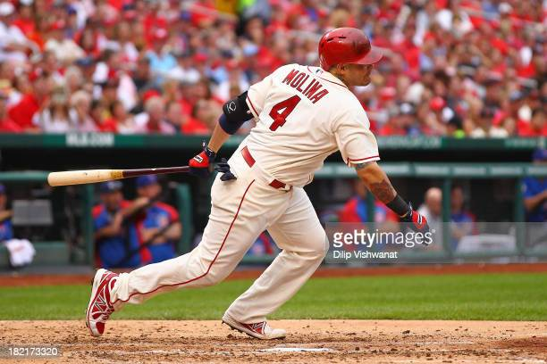 Yadier Molina of the St Louis Cardinals hits a twoRBI double against the Chicago Cubs in the third inning at Busch Stadium on September 28 2013 in St...