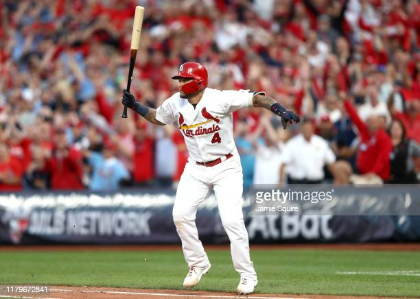 Yadier Molina of the St Louis Cardinals hits a walkoff sacrifice fly to give his team the 54 win over the Atlanta Braves in game four of the National...