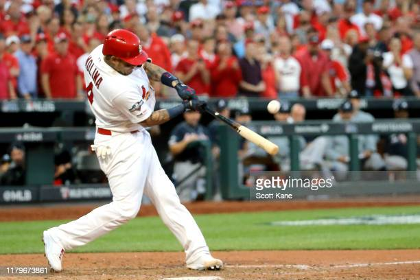 Yadier Molina of the St. Louis Cardinals hits a walk-off sacrifice fly to give his team the 5-4 win over the Atlanta Braves in game four of the...