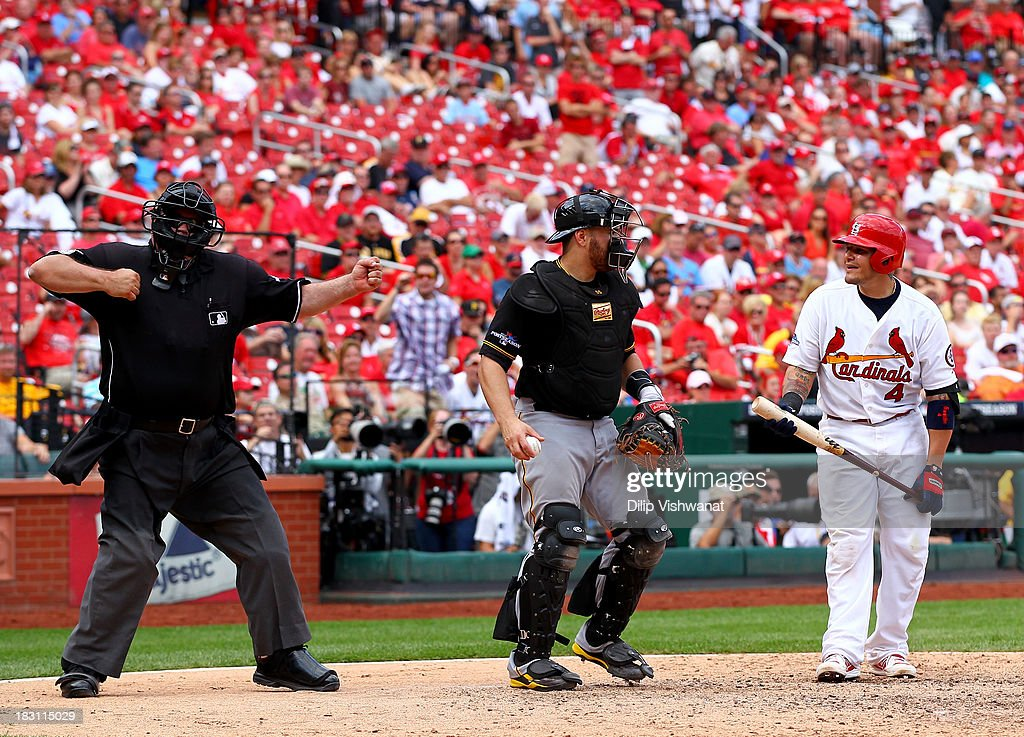 Yadier Molina #4 of the St. Louis Cardinals is called out in the ninth inning by umpire Wally Bell against the Pittsburgh Pirates during Game Two of the National League Division Series at Busch Stadium on October 4, 2013 in St Louis, Missouri.