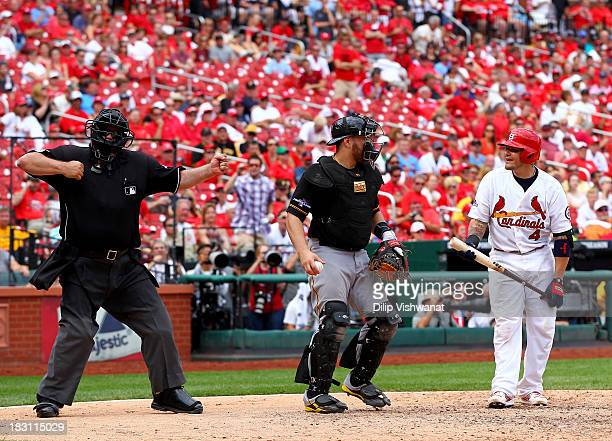 Yadier Molina of the St Louis Cardinals is called out in the ninth inning by umpire Wally Bell against the Pittsburgh Pirates during Game Two of the...