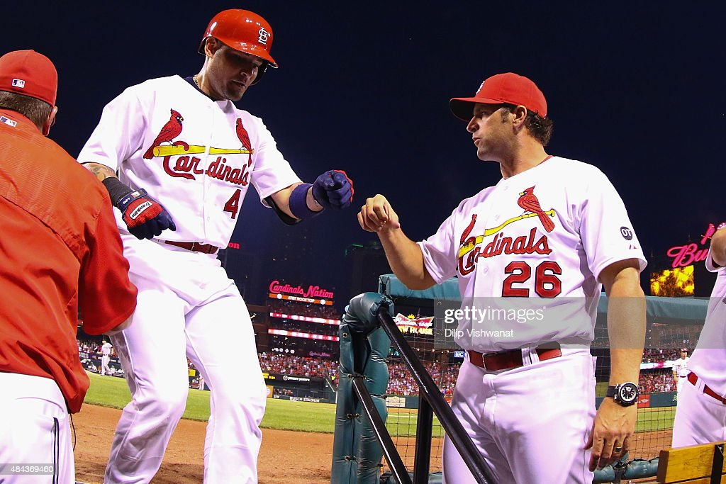 Yadier Molina #4 of the St. Louis Cardinals is congratulated by managaer Mike Matheny #26 after hitting a solo home run against the San Francisco Giants in the fourth inning at Busch Stadium on August 17, 2015 in St. Louis, Missouri.