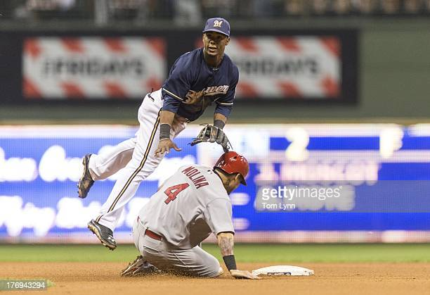 Yadier Molina of the St Louis Cardinals is forced out at second by Jean Segura of the Milwaukee Brewers in the eighth inning at Miller Park on August...