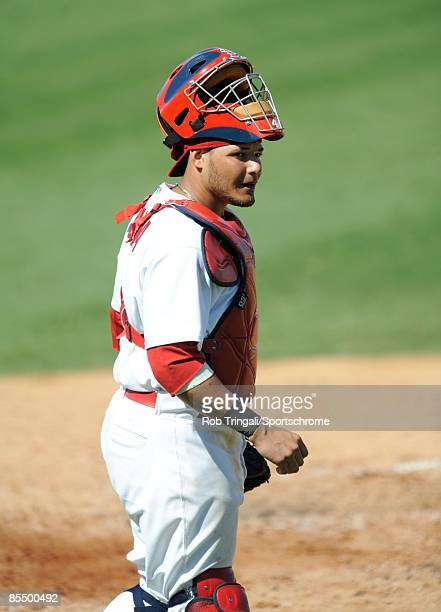 Yadier Molina of the St Louis Cardinals looks on against the Washington Nationals during a spring training game at Roger Dean Stadium on February 28...