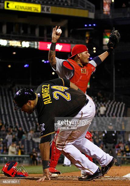 Yadier Molina of the St Louis Cardinals reacts after the safe call on Pedro Alvarez of the Pittsburgh Pirates during the game at PNC Park April 4...