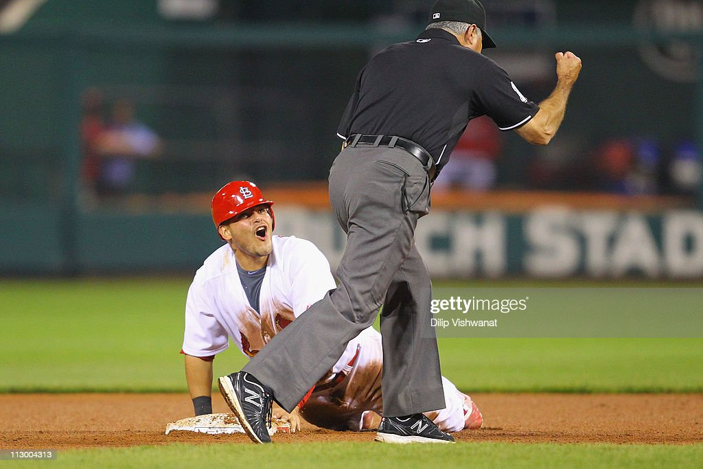 Yadier Molina #4 of the St. Louis Cardinals reacts to being called out after attempting to steal second base against the Cincinnati Reds at Busch Stadium on April 22, 2011 in St. Louis, Missouri.
