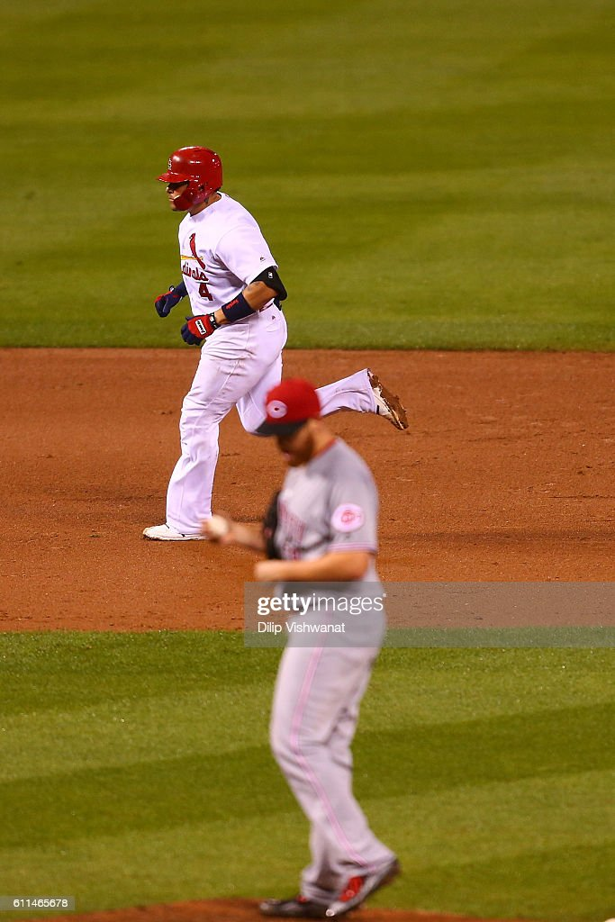 Yadier Molina #4 of the St. Louis Cardinals rounds the bases after hitting a solo home run against the Cincinnati Reds in the fifth inning at Busch Stadium on September 29, 2016 in St. Louis, Missouri.