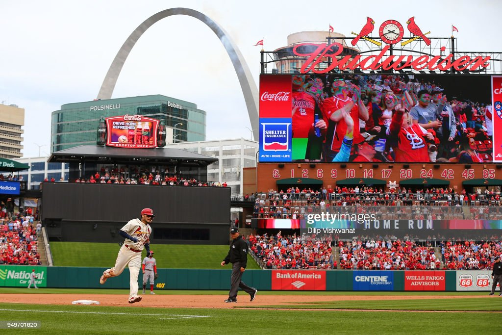 Yadier Molina #4 of the St. Louis Cardinals rounds third base after hitting the game-winning home run against the Cincinnati Reds in the seventh inning at Busch Stadium on April 21, 2018 in St. Louis, Missouri.