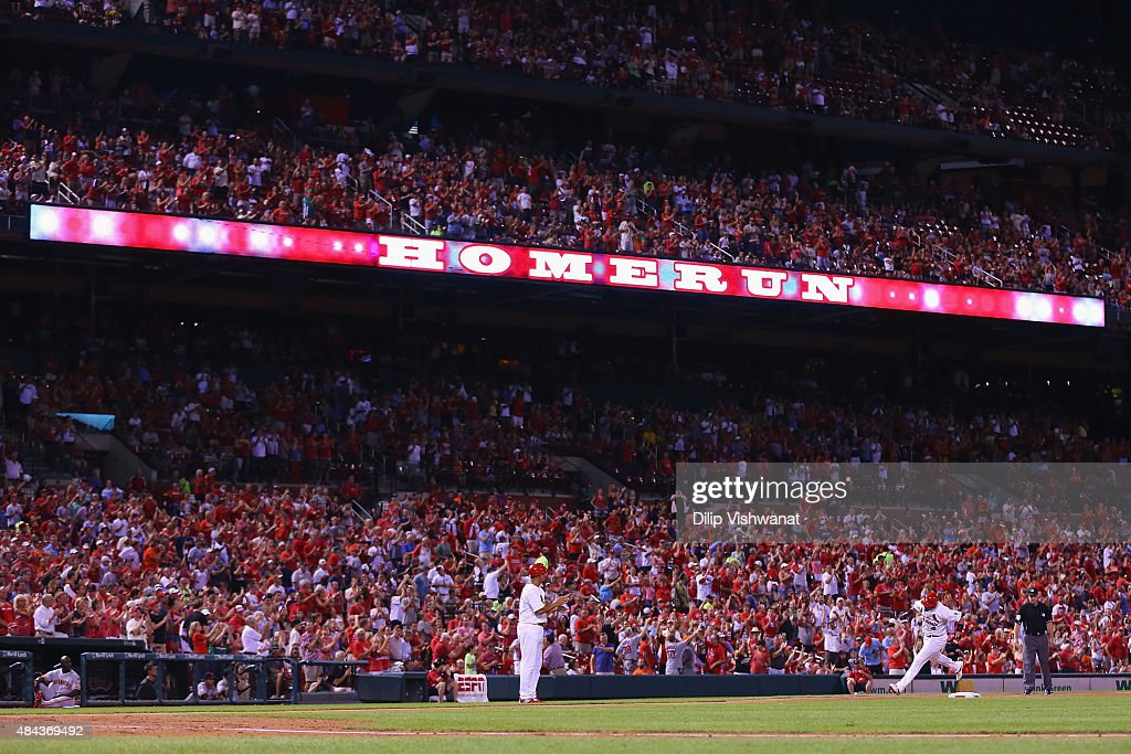 Yadier Molina #4 of the St. Louis Cardinals rounds third base on his solo home run against the St. Louis Cardinals in the fourth inning at Busch Stadium on August 17, 2015 in St. Louis, Missouri.