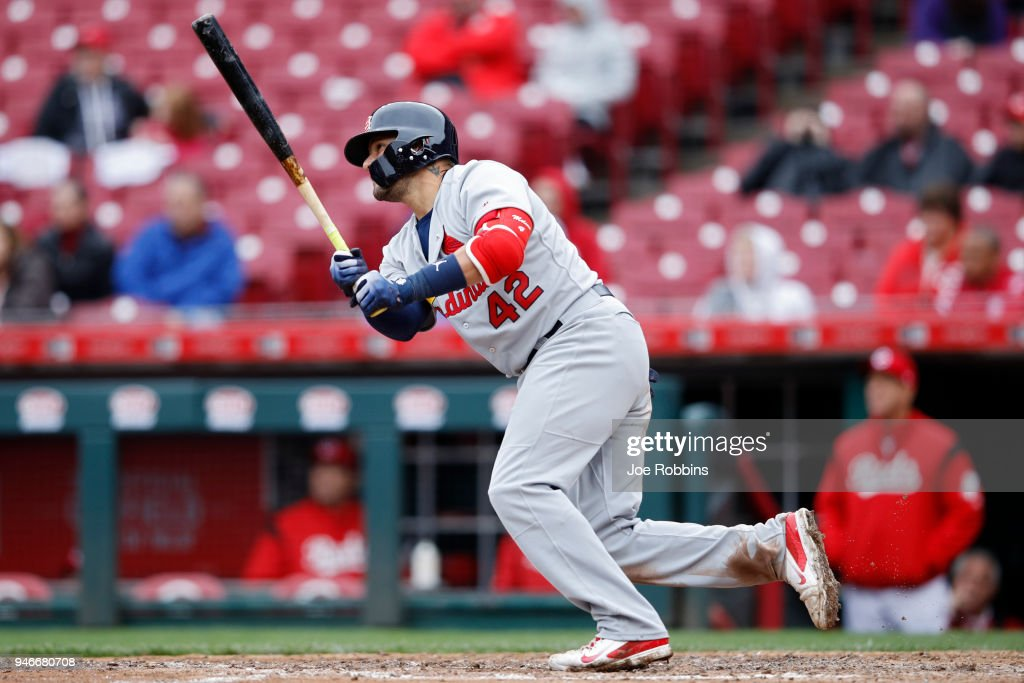 Yadier Molina #4 of the St. Louis Cardinals singles to drive in a run in the seventh inning of the game against the Cincinnati Reds at Great American Ball Park on April 15, 2018 in Cincinnati, Ohio. The Cardinals won 3-2. All players are wearing #42 in honor of Jackie Robinson Day.