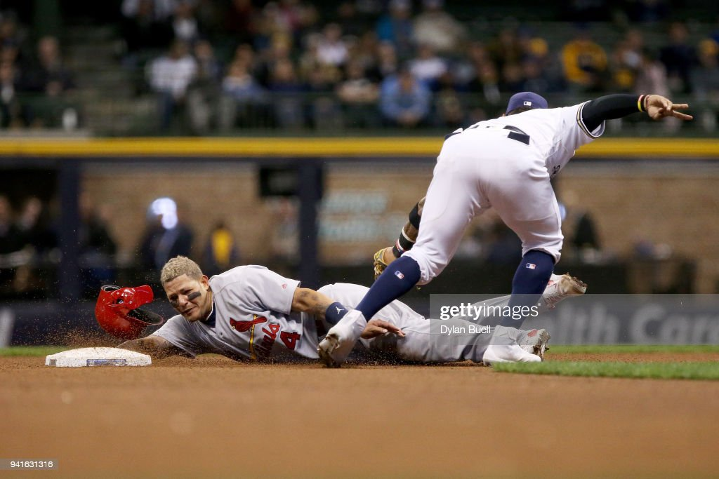 Yadier Molina #4 of the St. Louis Cardinals steals second base past Jonathan Villar #5 of the Milwaukee Brewers in the eighth inning at Miller Park on April 3, 2018 in Milwaukee, Wisconsin.