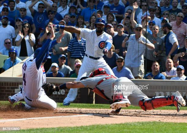 Yadier Molina of the St Louis Cardinals tags out Anthony Rizzo of the Chicago Cubs at home plate during the fourth inning on September 15 2017 at...