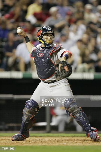 Yadier Molina of the St Louis Cardinals throws against the Colorado Rockies at Coors Field on July 24 2006 in Denver Colorado The Rockies defeated...