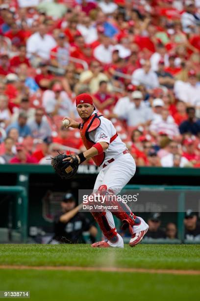 Yadier Molina of the St Louis Cardinals throws to first base against the Florida Marlins on September 16 2009 at Busch Stadium in St Louis Missouri