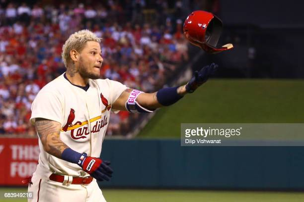 Yadier Molina of the St Louis Cardinals tosses his helmet in frustration after lining out against the Boston Red Sox in the third inning at Busch...