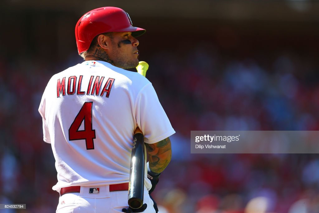 Yadier Molina #4 of the St. Louis Cardinals walks to the on-deck circle against the Arizona Diamondbacks in the seventh inning at Busch Stadium on July 30, 2017 in St. Louis, Missouri.
