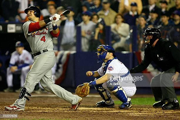 Yadier Molina of the St. Louis Cardinals watches his two-run homerun against the New York Mets in the ninth inning during game seven of the NLCS at...