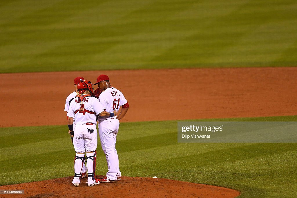 Yadier Molina #4 talks to starter Alex Reyes #61 of the St. Louis Cardinals during a Cincinnati Reds at bat in the sixth inning at Busch Stadium on September 29, 2016 in St. Louis, Missouri.