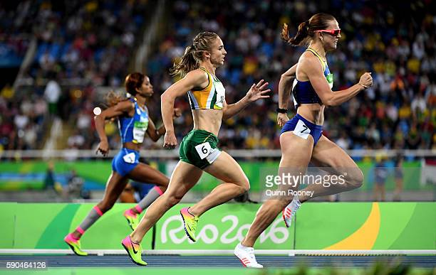Yadisleidis Pedroso of Italy Wenda Nel of South Africa and Anna Titimets of Ukraine compete during the Women's 400m Hurdles Semifinals on Day 11 of...
