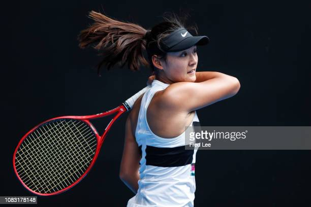 Yafan Wang of China plays a forehand in her second round match against Ashleigh Barty of Australia during day three of the 2019 Australian Open at...
