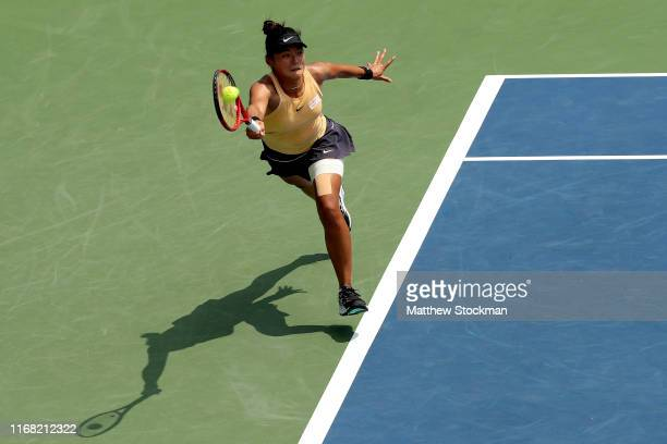 Yafan Wang of China returns a shot to Karolina Pliskova of Czech Republic during the Western & Southern Open at Lindner Family Tennis Center on...