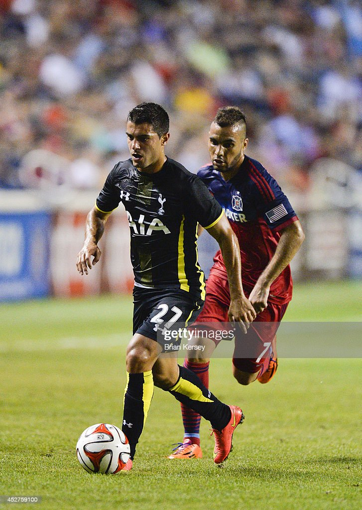 Yago Falque #27 of Tottenham Hotspur moves the ball up the field as Alex #7 of Chicago Fire defends during the second half at Toyota Park on July 26, 2014 in Bridgeview, Illinois. Tottenham Hotspur defeated the Fire 2-0.