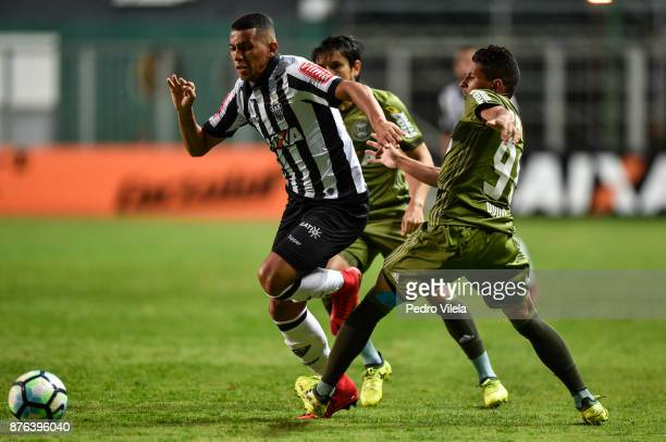 Yago of Atletico MG struggles for the ball with Dodo of Coritiba during a match between Atletico MG and Coritiba as part of Brasileirao Series A 2017...