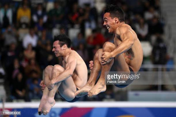 Yahel Castillo and Juan Manuel Celaya of Mexico compete in Men's Synchronised Diving 3m Springboard Final at Aquatics Center of Villa Deportiva...