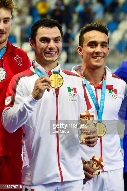 Yahel Castillo and Juan Manuel Celaya of Mexico pose during the Medal Ceremony after Men's Synchronised 3m Springboard Final on Day 8 of Lima 2019...