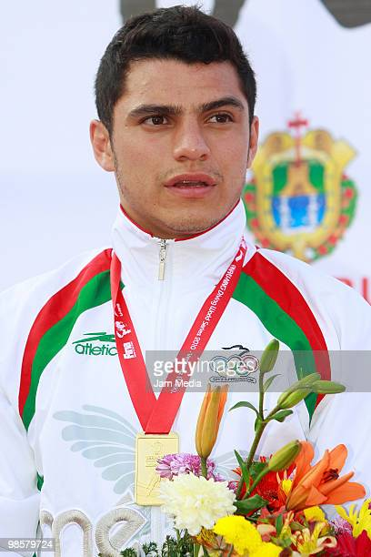 Yahel Castillo receives the gold medal of the 3 meter men's competition during the FINA Diving World Series 2010 at Leyes de Reforma pool on April 20...