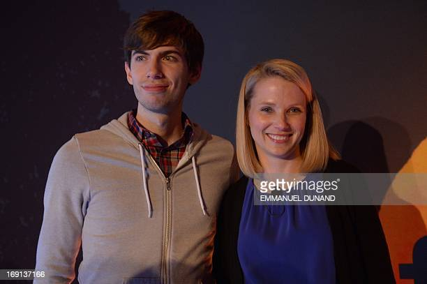 Yahoo CEO Marissa Mayer and Tumblr founder David Karp pose for a photo during an annoucement that Yahoo acquired the Tumblr blogging site in New York...