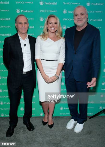 Yahoo Finance EditorinChief Andy Serwer Julia La Roche and Aetna Chairman CEO Mark Bertolini attend the Yahoo Finance All Markets Summit on October...