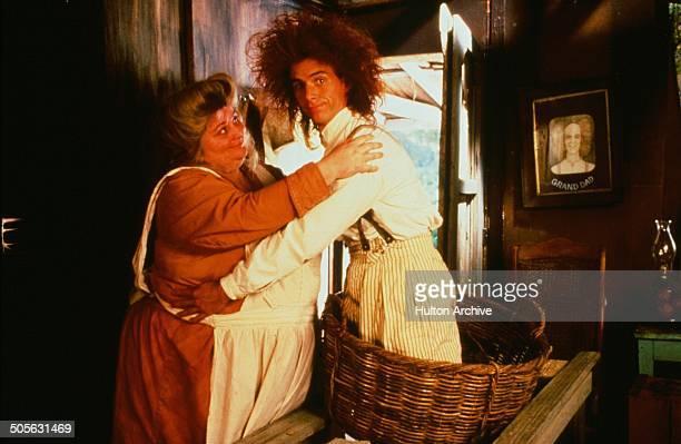 Yahoo Serious hugs Su Cruickshank in a scene from the Warner Bros movie 'Young Einstein' circa 1988