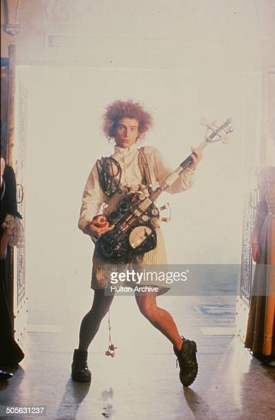 Yahoo Serious plays a guitar in a scene from the Warner Bros movie 'Young Einstein' circa 1988
